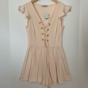Baby pink romper with cute sleeves